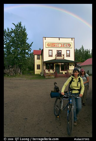 Women with bikes, hotel, and rainbow. McCarthy, Alaska, USA (color)