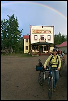 Women with bikes, hotel, and rainbow. McCarthy, Alaska, USA ( color)