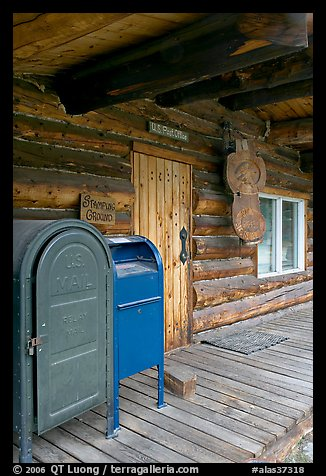 postal boxes, log house postal office, Slana. Alaska, USA (color)