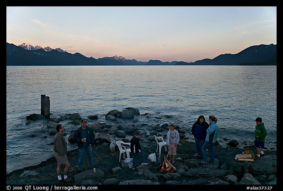 Families pickniking with fire, Resurrection Bay, sunset. Seward, Alaska, USA (color)