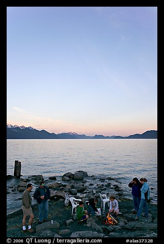 Family enjoying midnight picknik, Resurrection Bay, sunset. Seward, Alaska, USA (color)