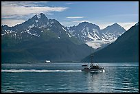 Fishing boat, mountains and glaciers. Seward, Alaska, USA