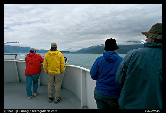 Passengers standing on deck with colorful  clothes. Seward, Alaska, USA (color)