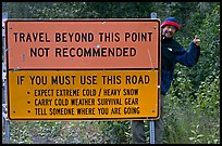 Sign with warnings about winter travel, Exit Glacier Road. Seward, Alaska, USA (color)