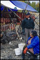 Inupiaq Eskimo man and woman next to fish hung for drying, Ambler. North Western Alaska, USA ( color)