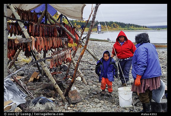 Inupiaq Eskimo family with stand of dried fish, Ambler. North Western Alaska, USA (color)