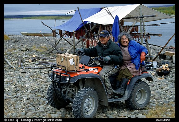 Inupiaq Eskimo man and woman riding on a four-wheeler, Ambler. North Western Alaska, USA (color)