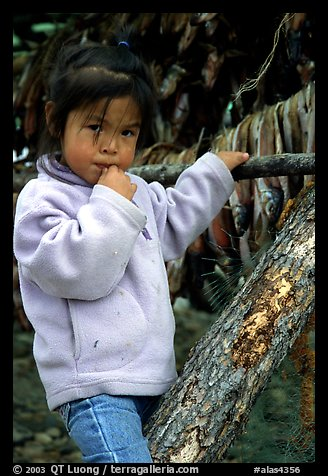 Inupiaq Eskimo girl near drying fish, Ambler. North Western Alaska, USA (color)