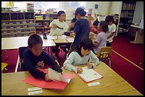 Inupiaq Eskimo kids in the classroom. Note names on table. Kiana. North Western Alaska, USA ( color)