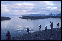 Fishing for salmon in the Spit's Fishing Hole. Homer, Alaska, USA (color)