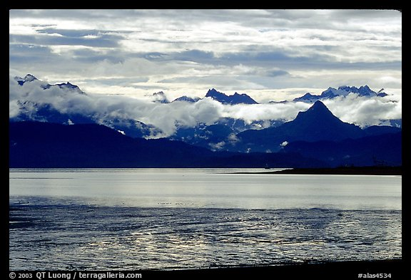 Low clouds haning over Kenai Mountains across Katchemak Bay. Homer, Alaska, USA (color)