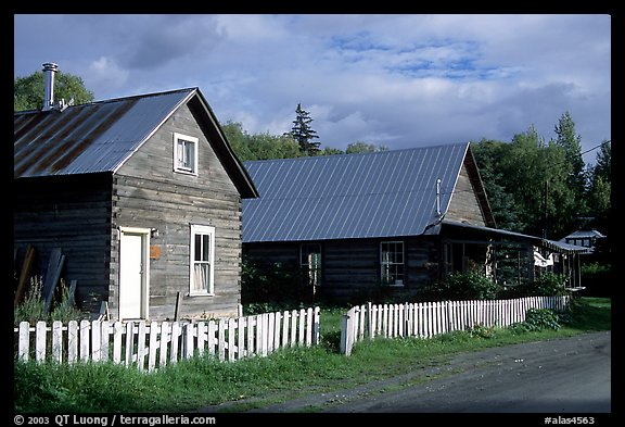 White picket fence and wooden houses. Hope,  Alaska, USA (color)
