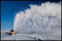 Snow plow truck with cloud of snow. Alaska, USA ( color)