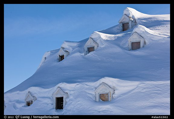 Snow-covered roof with windows. Alaska, USA (color)
