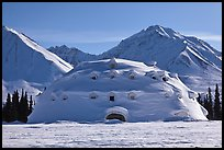 Snowy dome-shaped building and mountains. Alaska, USA ( color)