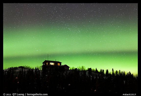 House and Northern Lights filled sky. Alaska, USA (color)