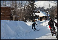 Winter recreation with snow-tired bike and skis. Wiseman, Alaska, USA ( color)