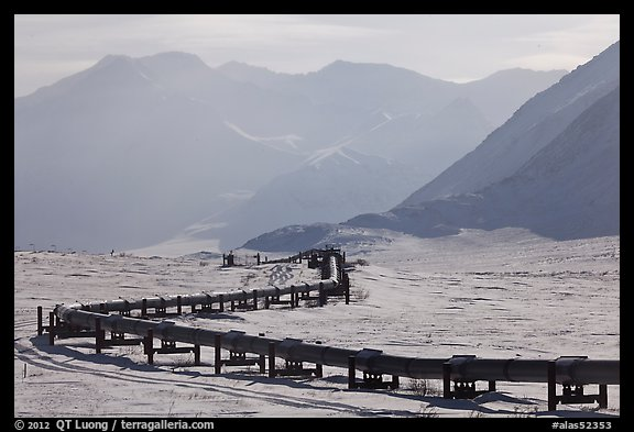 Alaska Pipeline snaking below Arctic Brooks mountains in winter. Alaska, USA (color)