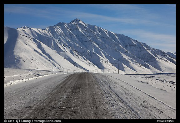 Frozen James Dalton Highway below Arctic Mountains. Alaska, USA (color)