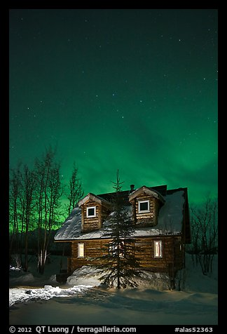 Cabin at night with Northern Lights. Wiseman, Alaska, USA