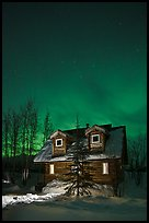 Cabin at night with Northern Lights. Wiseman, Alaska, USA ( color)