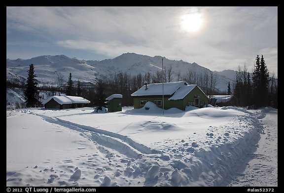 Backlit view of snow-covered village. Wiseman, Alaska, USA (color)