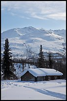 Snowy cabin and mountains. Wiseman, Alaska, USA (color)