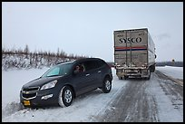 Commercial truck towing car, Dalton Highway. Alaska, USA (color)