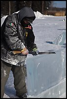 Ice artist carving with saw. Fairbanks, Alaska, USA (color)