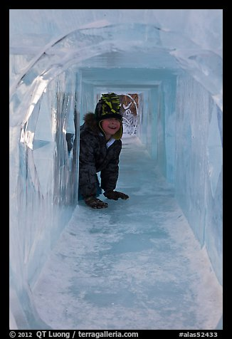 Girl inside ice tunnel, Ice Alaska. Fairbanks, Alaska, USA (color)