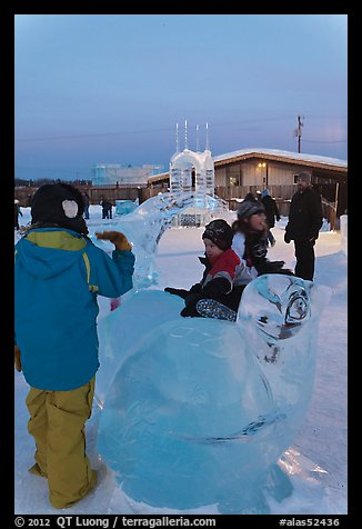 Children playing on ice sculptures, Ice Alaska. Fairbanks, Alaska, USA