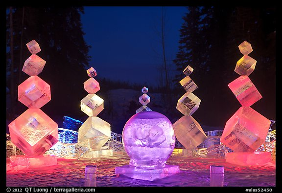Balancing cubes made of ice at night, World Ice Art Championships. Fairbanks, Alaska, USA (color)