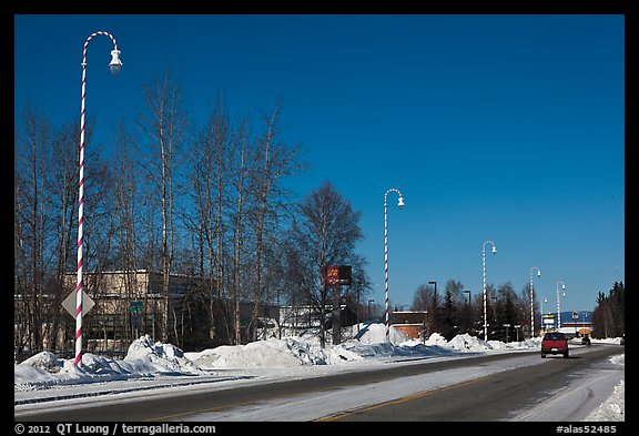 Main street and white street lights with red stripes. North Pole, Alaska, USA (color)