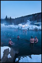 People soak in natural hot springs in winter. Chena Hot Springs, Alaska, USA ( color)