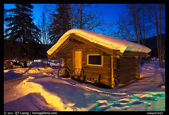 Snowy log cabin at night. Chena Hot Springs, Alaska, USA (color)