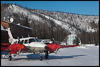 Plane with engine block warmers on frozen runway. Chena Hot Springs, Alaska, USA ( color)