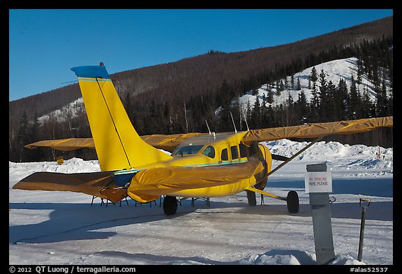 Plane on frozen runway in winter. Chena Hot Springs, Alaska, USA (color)