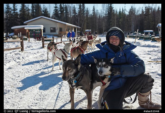 Woman dog musher posing with dog team. Chena Hot Springs, Alaska, USA (color)
