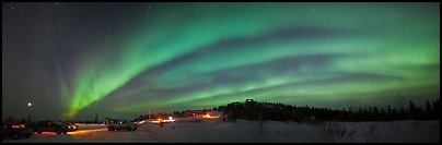Northern Lights streaking above cars and cabin at Cleary Summit. Alaska, USA (Panoramic color)