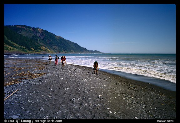 Backpacking on black sand beach, Lost Coast. California, USA (color)
