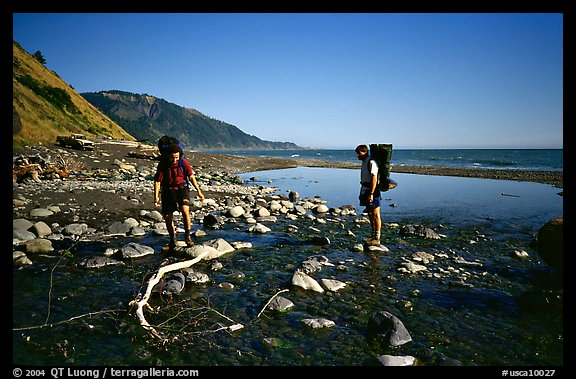 Backpackers cross a stream, Lost Coast. California, USA (color)