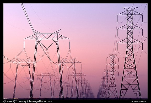 High voltage power lines at dusk. California, USA (color)