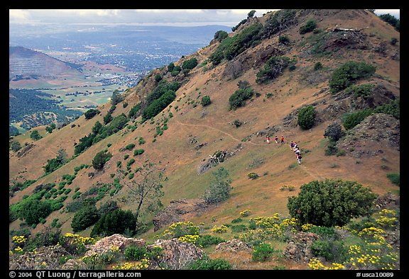 Group of Hikers on a distant trail, Mt Diablo State Park. California, USA (color)