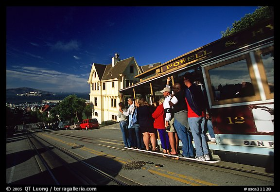 Cable car and Tudor house, Hyde Street, late afternoon. San Francisco, California, USA (color)
