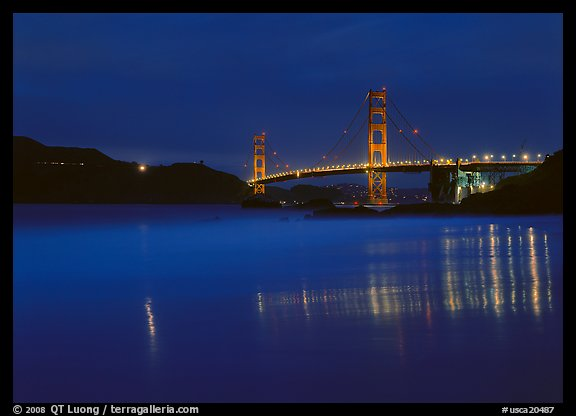 Golden Gate Bridge reflected in wet sand, blue hour. San Francisco, California, USA (color)