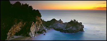Seascape at sunset with coastal waterfall. Big Sur, California, USA (Panoramic color)