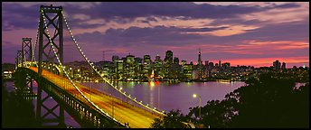 San Francisco cityscape and Bay Bridge at sunset. San Francisco, California, USA (Panoramic color)