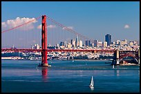 Sailboat, Golden Gate Bridge with city skyline, afternoon. San Francisco, California, USA