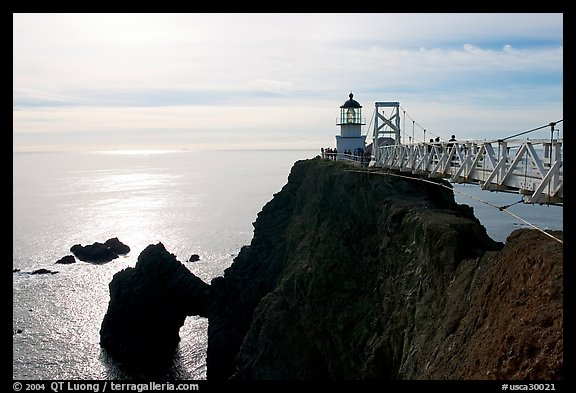 Narrow bridge leading to the Point Bonita Lighthouse, afternoon. California, USA (color)
