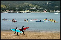 Surfers and sea kayakers, Pillar point harbor. Half Moon Bay, California, USA ( color)